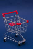 Shopping Cart. On a bluebackground Stock Images
