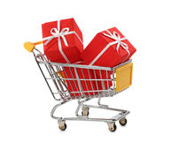 Shopping cart. With presents isolated on white background Royalty Free Stock Photo