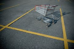 Shopping cart. On a deserted parking lot stock photography