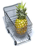 Shopping cart. Miniature model of a shopping cart with pineapple inside royalty free stock photo
