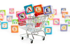 Shopping cart against  background Stock Photography