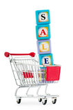 Shopping cart against the white Royalty Free Stock Photography