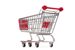 Shopping cart against the white Royalty Free Stock Photo