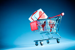 Shopping cart ahd gift Royalty Free Stock Image