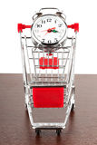 Shopping cart and alarm clock Royalty Free Stock Photography