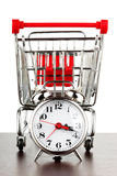 Shopping cart and alarm clock Stock Photo