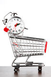 Shopping cart and alarm clock Royalty Free Stock Photo