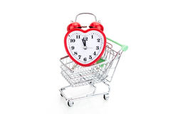 Shopping cart with alarm clock in shape of a heart Stock Image