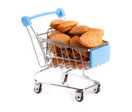 Shopping cart with almonds isolated on white background Stock Images