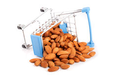 Shopping cart with almonds isolated on white background Royalty Free Stock Images