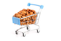 Shopping cart with almonds isolated on white background Stock Image