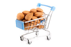 Shopping cart with almonds isolated on white background Royalty Free Stock Photography