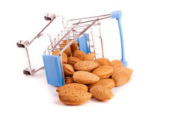Shopping cart with almonds  on white background Royalty Free Stock Images