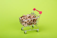 Shopping cart with alphabet Royalty Free Stock Photo