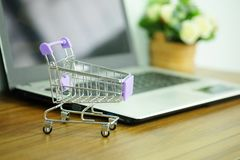 Free Shopping Cart And Laptop Computer, Concepts Online Shopping Where Consumers Can Buy Products Directly Stock Photo - 159375490