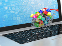 Shopping cart with applicatio icons on laptop Stock Photography