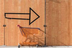 With the shopping cart always on the arrow on shoppingtour royalty free stock photo