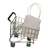 Shopping cart with bag Stock Images