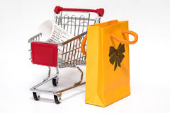 Shopping cart and bag Stock Photos