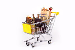 Shopping cart with bags Stock Photos