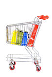 Shopping cart and bags Royalty Free Stock Photos