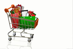 Shopping cart and bags for christmas gifts and shopping in troll Royalty Free Stock Photo
