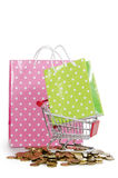 The shopping cart and bags and coins Royalty Free Stock Photography