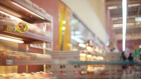 Shopping cart in bakery with fresh bread. Shopping cart In a grocery store with fresh bread. 1920x1080. Hd stock footage