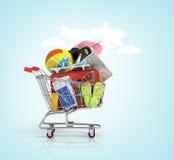 Shopping cart with beach accessories. Summer shopping. Sunbed, sunglasses, world map, beach shoes, sunscreen, passport, air tickets, beach ball, camera, hat Stock Photos