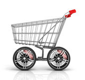 Shopping cart with big car wheel Stock Photography