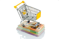 Shopping cart on bills. Shopping cart is on banknotes, symbolic photo for shopping, purchasing power, money printing and inflation Royalty Free Stock Photography