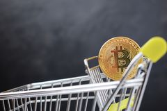 Shopping cart and bitcoin. Concept of cryptocurrency market. Buying cryptocurrency, investing in new money background digital gold virtual business symbol royalty free stock image