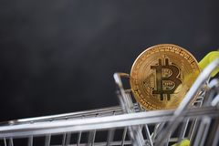 Shopping cart and bitcoin. Concept of cryptocurrency market. Buying cryptocurrency, investing in new money background digital gold virtual business symbol stock photography