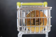 Shopping cart and bitcoin. Concept of cryptocurrency market. Buying cryptocurrency, investing in new money background digital gold virtual business symbol stock images