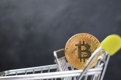 Shopping cart and bitcoin. Concept of cryptocurrency market. Buying cryptocurrency, investing in new money background digital gold virtual business symbol royalty free stock photography