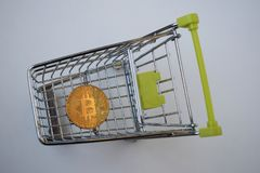 Shopping cart and bitcoin. Concept of cryptocurrency market. Buying cryptocurrency, investing in new money background digital gold virtual business symbol royalty free stock photos