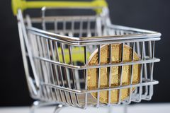 Shopping cart and bitcoin. Concept of cryptocurrency market. Buying cryptocurrency, investing in new money background digital gold virtual business symbol royalty free stock images