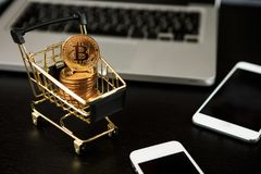 Shopping cart with bitcoin on laptop. Cryptocurrency Concept Stock Images