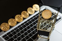 Shopping cart with bitcoin on laptop. Cryptocurrency Concept royalty free stock images
