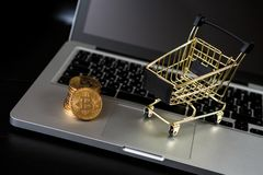 Shopping cart with bitcoin on laptop. Cryptocurrency Concept stock photo