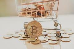 Shopping cart and bitcoin royalty free stock photo
