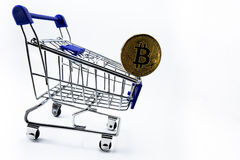 Shopping cart and  bitcoin Royalty Free Stock Photos