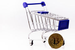 Shopping cart with bitcoin Royalty Free Stock Photo