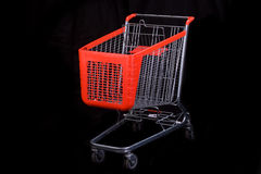 Shopping cart on black background Stock Image