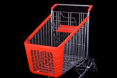 Shopping cart on black background Stock Photos