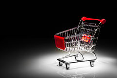 Shopping cart on black background Royalty Free Stock Images