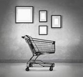 Shopping cart and blank frames. Shopping cart with empty frames in the room Stock Images