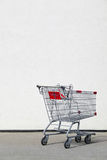 Shopping cart with blank wall background Stock Photo