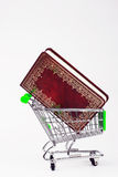 Shopping Cart with a book Royalty Free Stock Images