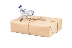 Shopping cart on box on white isolated Royalty Free Stock Photos